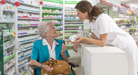 Pharmacist helping a lady in a wheelchair